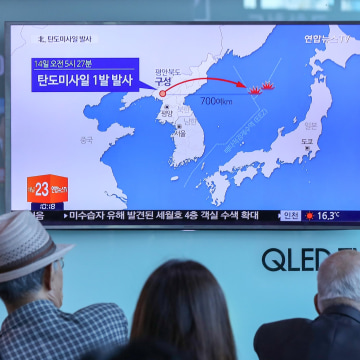 Image: People watch a news report on North Korea firing a ballistic missile, at a railway station in Seoul