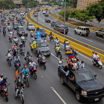 Image: Venezuelan opponents travel in caravans in protest against the government
