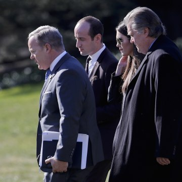 Image: Spicer, Miller, Hicks, and Bannon walk across the South Lawn of the White House