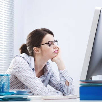 Image: Woman bored at work