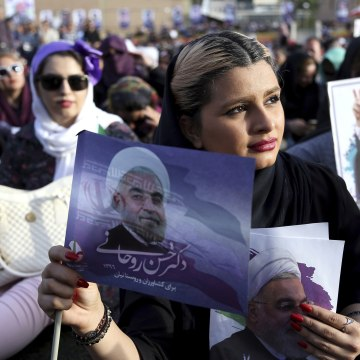 Image: A supporter of Iran's President Hassan Rouhani