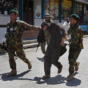 Image: Afghan soldiers capture a suspected militant after the Jalalabad attack.