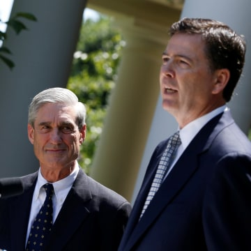 Image: James Comey speaks alongside outgoing FBI Director Robert Mueller at the White House in Washington