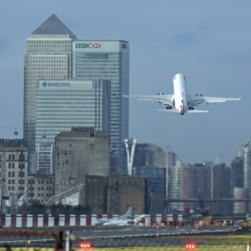 Image: A British Airways plane takes off at London City Airport