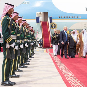 Image: Saudi Arabia's King Salman bin Abdulaziz Al Saud and U.S. President Donald Trump walk during a reception ceremony in Riyadh