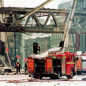 Image: Emergency workers after Manchester explosion on June 15, 1996