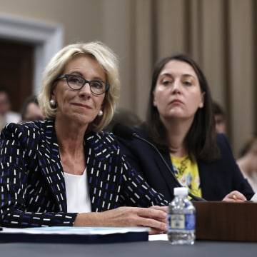 Image: Betsy DeVos and Erica Navarro  on Capitol Hill in Washington