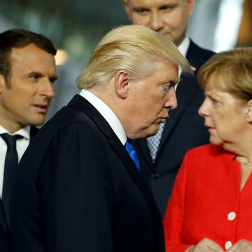Image: President Donald Trump walks past French President Emmanuel Macron and German Chancellor Angela Merkel