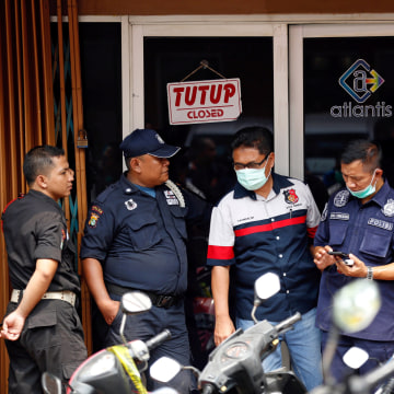 Image: FILE PHOTO: Police and security are seen outside the club where police detained 141 men for what they described as a gay prostitution ring in Jakarta