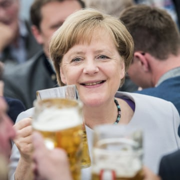 Image: German Chancellor Angela Merkel drinks from a beer during an election campaign event of the German Christian Social Union (CSU) party at the 46th Truderinger Festwoche festival week in Munich, Bavaria, Germany, May 28, 2017.