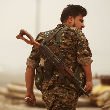 Image: A member of the Kurdish People's Protection Units in Raqqa, Syria