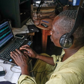 Image: A local volunteer at Radio Mbari in Bangassou edits together an interview he conducted of a local official