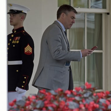 Image: Michael Dubke walks out of the West Wing of the White House in Washington