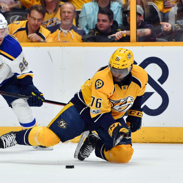 Image: P.K. Subban plays the puck after being knocked to the ice