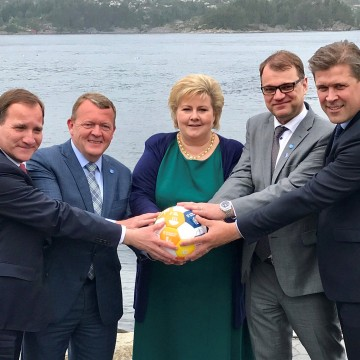 Image: Sweden's PM Lofven with his counterparts Rasmussen of Denmark, Solberg of Norway, Sipila of Finland and Benediktsson of Iceland hold a soccer ball during their meeting in Bergen