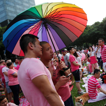 Image: FILE PHOTO: Participants dressed in pink enjoy a picnic before taking part in the forming of a giant pink dot at the Speakers' Corner in Hong Lim Park