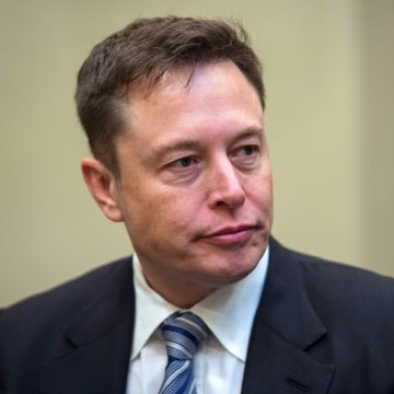 Image: Elon Musk listens to President Donald Trump speak during a meeting with business leaders at the White House