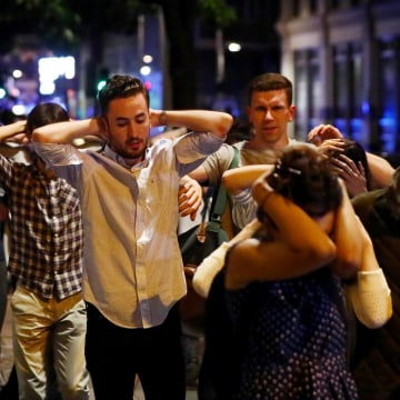 Image: People leave the area with their hands up after an incident near London Bridge in London, Britain, in the early hours of June 4, 2017.