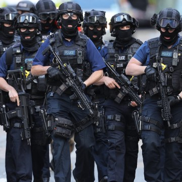 Image: Counter-terrorism officers march near the scene of the London Bridge attack