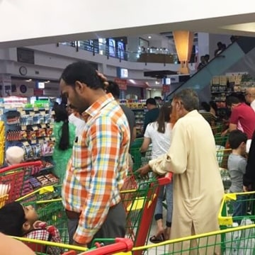 Image: People are seen buying essential food staples in Doha