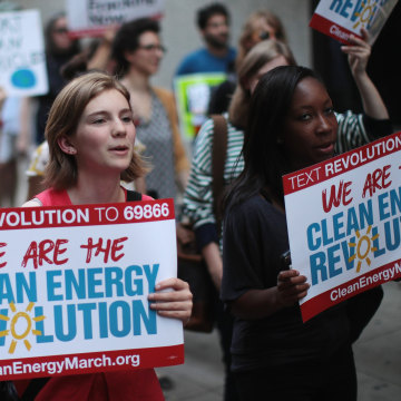 Image: Demonstrators protest President Donald Trump's decision to exit the Paris climate change accord