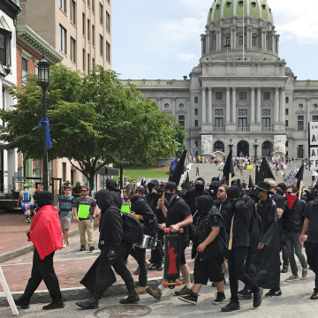 Image: Demonstrators march during an Anti-Sharia rally in front of the State Capitol building in Harrisburg