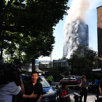 Image: Media outside a huge tower block fire in West London