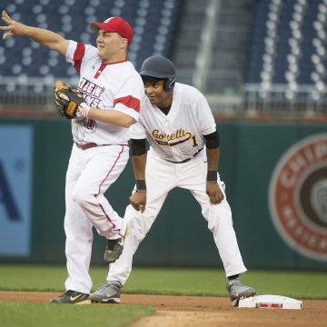 Image: Reps. Cedric Richmond, D-La., right, and Steve Scalise, R-La., play in the 55th Congressional Baseball Game