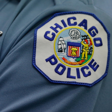 Image: FILE PHOTO: A Chicago police officer attends a news conference announcing the department's plan to hire nearly 1,000 new police officers in Chicago