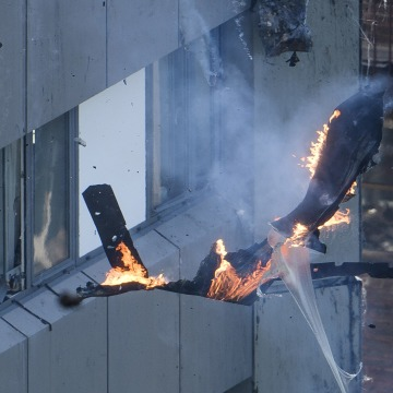 Image: Burning debris falls off Grenfell Tower