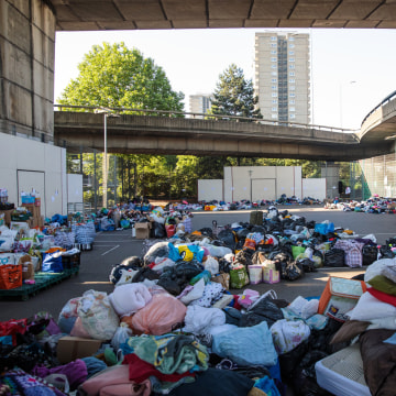 Image: Donations of clothing piled up at the Westway Sports Centre