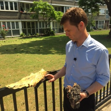 Image: ITV News' Nick Wallis holds chunks of the building's outer layer that rained down during the fire.