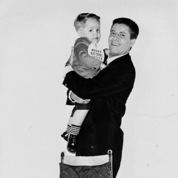 Image: Jerry Lewis holds a child with Muscular Dystrophy