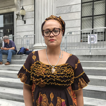 Image: Jewel Allison stands on the courthouse steps after a mistrial is declared in the Bill Cosby case, June 17, 2017.
