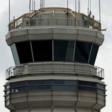 Image: A plane takes off from Ronald Reagan Washington National Reagan Airport