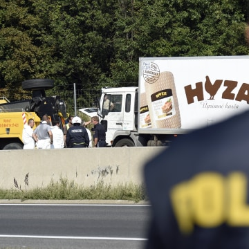 Image: The truck in which the refugees suffocated was found on a freeway in Austria in August, 2015.