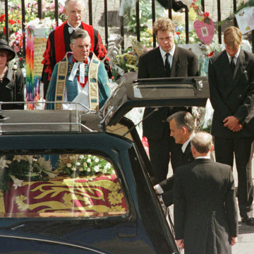 Image: Earl Spencer (2L) Prince William (3L) , Prince Harry and Prince Charles (R) watch as the coffin of Diana, Princess of Wales is placed into a hearse