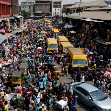 Image: People crowd a street at the central business district in Nigeria's commercial capital Lagos ahead of Christmas
