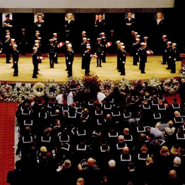 Image: U.S. Navy, sailors fold seven U.S. flags