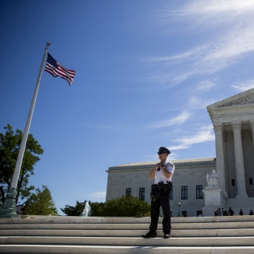 Image: A police officer stands outside the U.S. Supreme Court