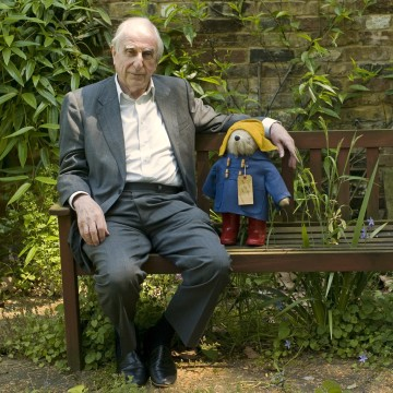 Image: Michael Bond sits with a Paddington Bear