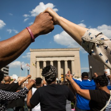 Activists Rally At Baltimore City Hall