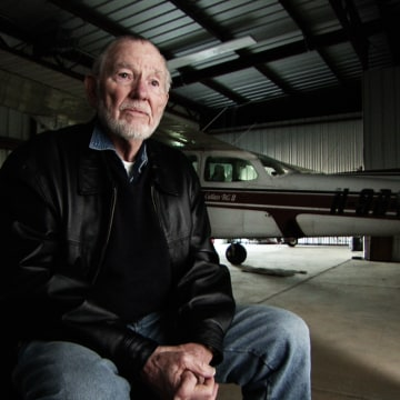 Image: John Billings sits in front of his Cessna