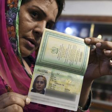 Image: Pakistani transgender Farzana Riaz displays her newly-obtained passport in Peshawar on June 28, 2017.