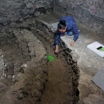 Image: Lorena Vazquez, an archaeologist from the National Institute of Anthropology and History (INAH), works at a site near Templo Mayor