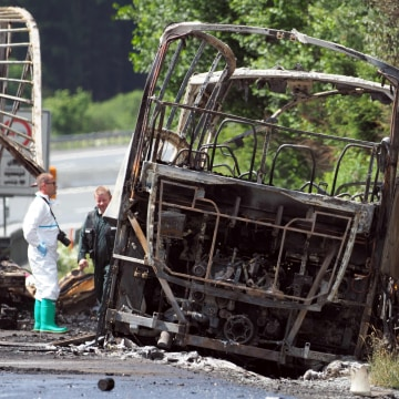 Image: Forensic experts at scene of the tour bus crash near M?nchberg, Germany.