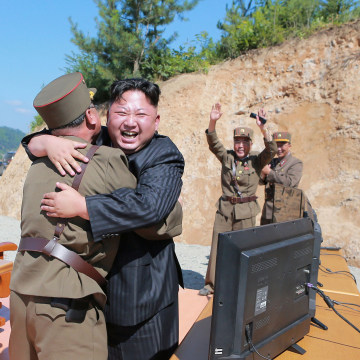 Image: North Korean leader Kim Jong Un reacts with scientists and technicians of the DPRK Academy of Defence Science after the test-launch of Hwasong-14 in this undated photo released by KCNA