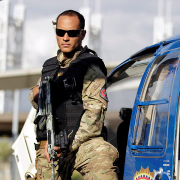 Image: Police official Oscar Perez poses for photographs during an event of the Body of Scientific, Penal and Criminal Investigation in Caracas