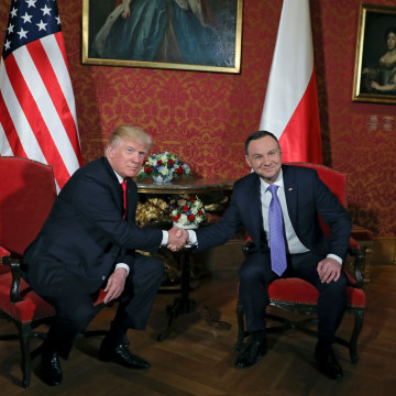 Image: U.S. President Donald Trump shakes hands with Polish President Andrzej Duda in Warsaw