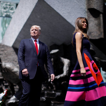 Image: Trump and first lady Melania Trump walk to the podium at Krasinski Square